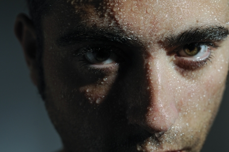 dark skin: Closed portrait of a man with water drops  Stock Photo