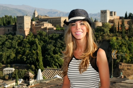 granada: Portrait of an attractive smiling blonde woman with sun hat