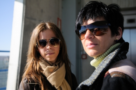 Two attractive women with sunglasses photo