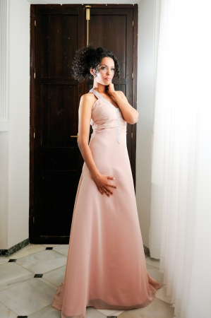 Portrait of a young black woman, model of fashion, with pink dress photo