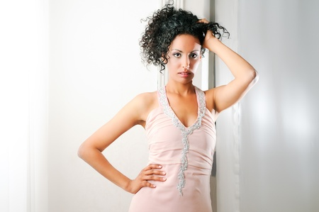 Portrait of a young black woman, model of fashion, with pink dress Stock Photo - 16636879