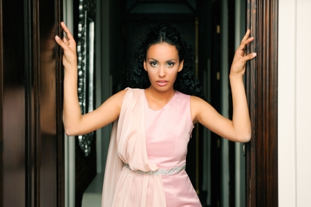 ethnic dress: Portrait of a young black woman, model of fashion, with pink dress Stock Photo