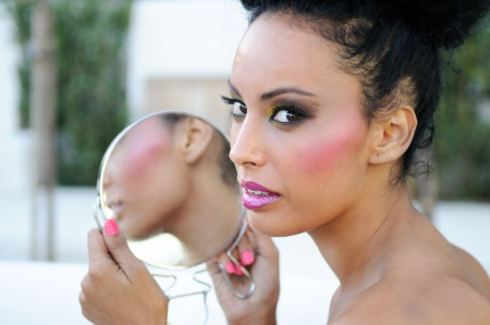 mirror face: Portrait of beautiful black girl with mirror