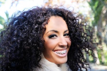 cute braces: Happy black girl with braces