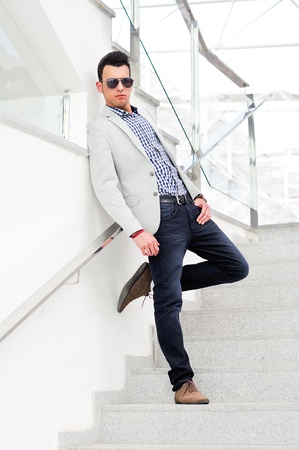 citylife: Portrait of a young handsome man, model of fashion, wearing tinted sunglasses Stock Photo