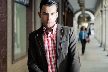 model nice: Portrait of a young handsome man, model of fashion, wearing jacket and shirt in urban background