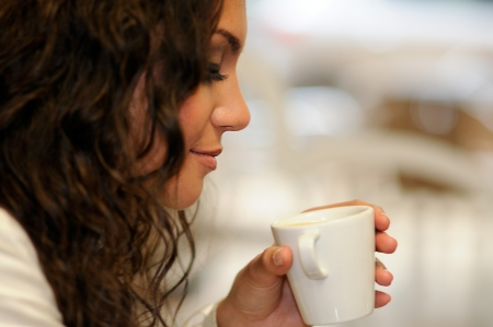 flavor: Portrait of beautiful elegant woman with coffee cup  Stock Photo