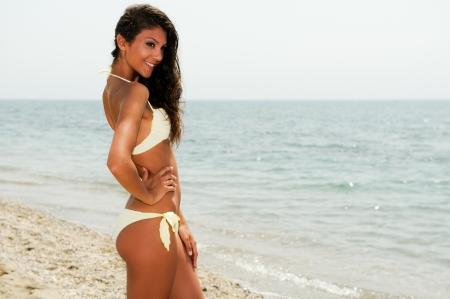 bikini island: Portrait of a woman with beautiful body on a tropical beach  Stock Photo