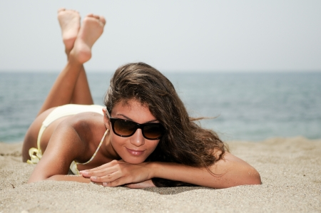 Portrait of a woman with beautiful body on a tropical beach  Stock fotó