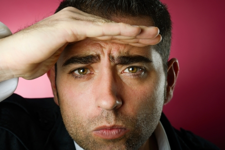 Close up studio portrait of a serious man looking at the background Stock Photo - 16826173