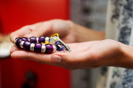 Close-up of hands of woman taking a bracelet in a jewelry store Stock Photo - 16826167