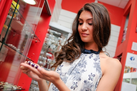 Portrait of attractive young woman buying a bracelet at a jewelry Stock Photo - 16826131