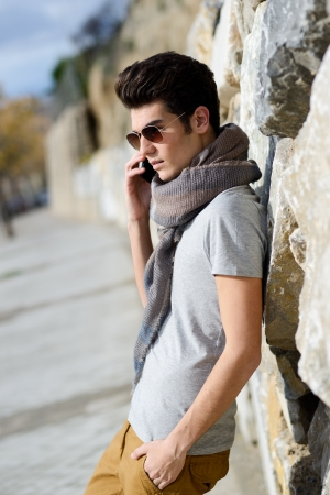 Portrait of handsome man in urban background talking on phone Stock fotó