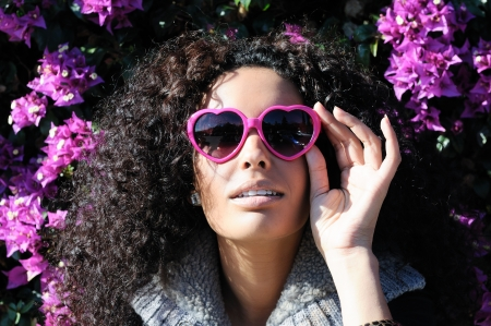 Funny black girl with purple heart glasses Stock fotó