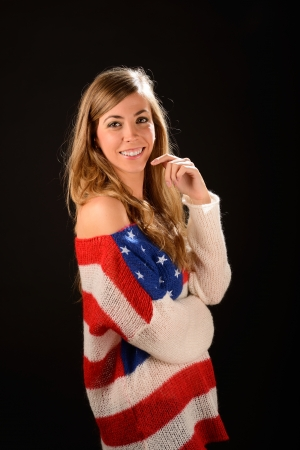 sweater girl: Portrait of a beautiful blonde girl wearing a sweater with the flag of United States