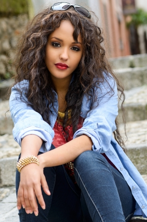 mixed race ethnicity: Portrait of attractive mixed woman in urban background wearing casual clothes Stock Photo