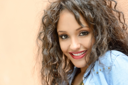 Portrait of attractive mixed woman in urban background wearing casual clothes Stock fotó