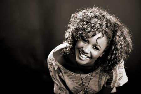 Portrait of beautiful black woman on black background  Studio shot