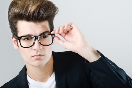 eyewear: Portrait of a young man with eyeglasses