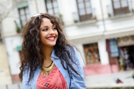Portrait of attractive mixed woman in urban background wearing casual clothes Banco de Imagens