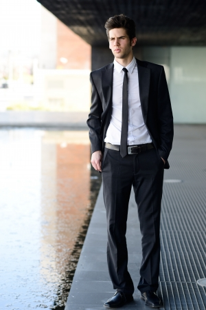 stylish men: Portrait of an attractive young businessman in an office building