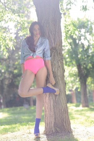 pink panties: Portrait of a beautiful young woman, model of fashion, in a garden wearing pink panties and haigh heels Stock Photo