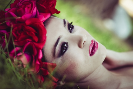 Close-up portrait of young beautiful japanese woman with pink and red flowers, model is an asian beauty  photo
