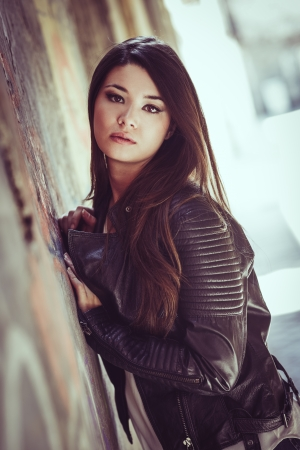 life jackets: Portrait of beautiful japanese woman in urban background wearing leather jacket
