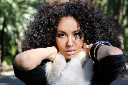 Portrait of a young black woman, afro hairstyle, in urban background Stock Photo