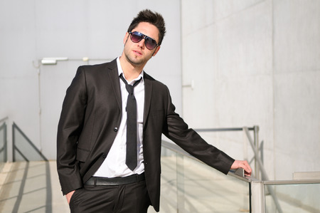 Portrait of a handsome young businessman with sunglasses photo