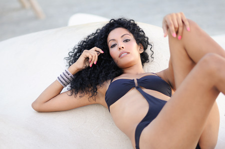 Portrait of a young black woman, afro hairstyle, wearing bikini photo