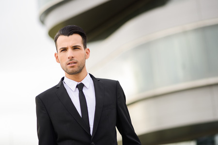 Portrait of a young businessman near a office building photo