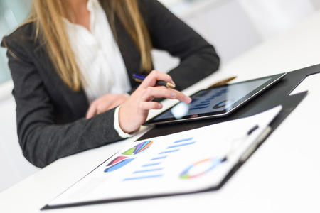 person woman: Portrait of young pretty business woman with tablet computer in the office