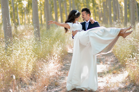 Just married couple together in poplar background