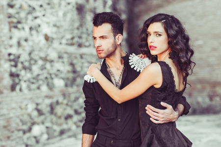 female pose: Portrait of beautiful couple, models of fashion, wearing spanish clothes Stock Photo