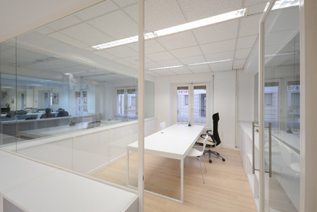 working space: Empty modern office with white furniture