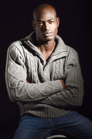 american sexy: Portrait of black man wearing casual clothes in black background