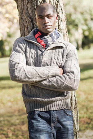 Portrait of black man wearing casual clothes in urban background photo