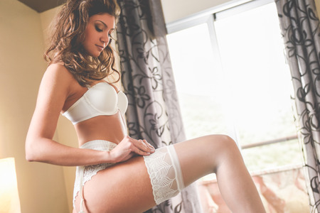 sensual nude: Sexy young woman wearing bride lingerie. White bra and panties Stock Photo