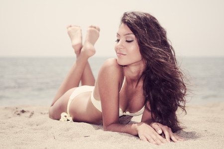 Portrait of a woman with beautiful body on a tropical beach photo