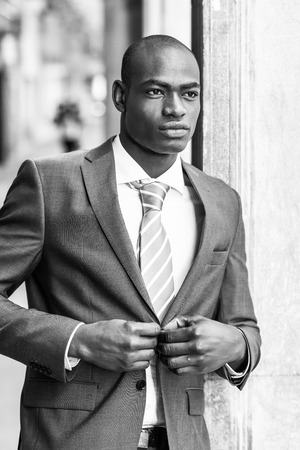 good looking man: Portrait of handsome black man wearing suit in urban background
