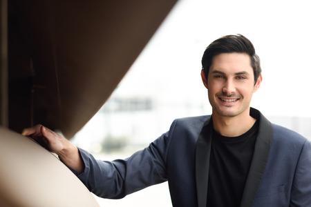 male model: Portrait of an attractive man, model of fashion, wearing modern suit.