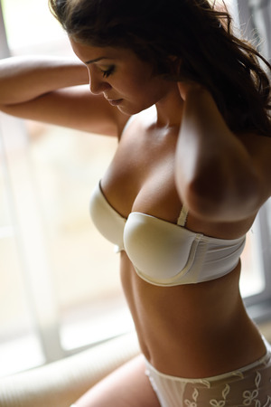 boudoir: Sexy young woman wearing bride lingerie. White bra and panties Stock Photo