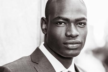 Portrait of handsome black man wearing suit in urban background
