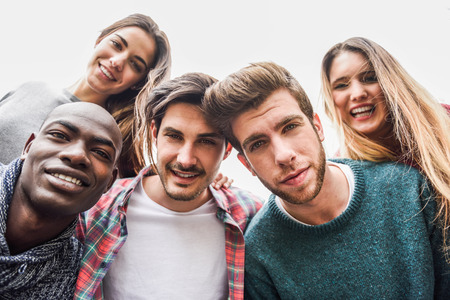 Group of multi-ethnic young people having fun together outdoors in urban background