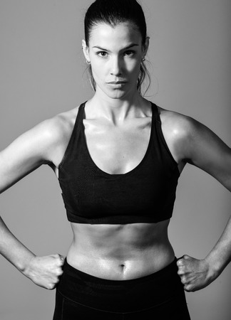 Portrait of woman, personal trainer, wearing black sportswear