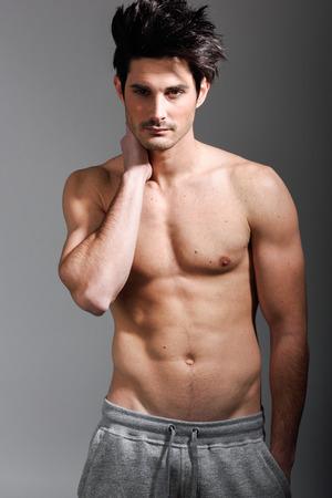 half naked: Portrait of half naked sexy body of muscular athletic man. Studio shot Stock Photo