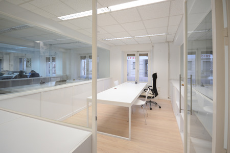 office furniture: Empty modern office with white furniture