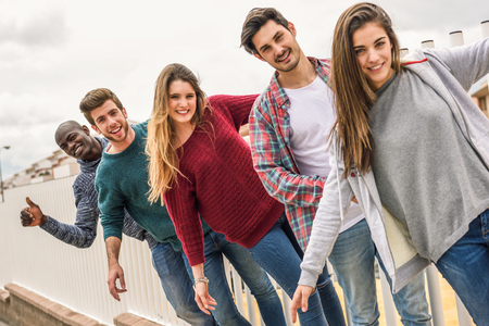 young group: Group of multi-ethnic young people having fun together outdoors in urban background