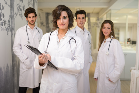 workers group: Portrait of group of medical workers in hospital
